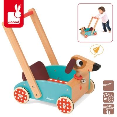Drewniany wózek pchacz w kolorze niebieskim przypominający kształtem pieska.