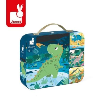 Kartonowa walizka z obrazkiem z dinozaurem .